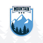 Mountain emblem with mountain view illustration and trees as background