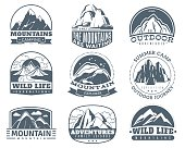 Mountain emblems. Hiking labels with snow mountains peak landscape. Camp and tourism vintage vector logo set