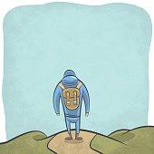 Mountain hiker walking in the wild