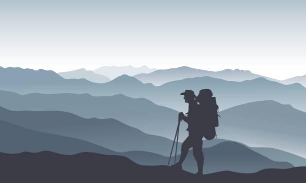 berglandschaft mit dunkle silhouette eines touristen - nationalpark stock-grafiken, -clipart, -cartoons und -symbole