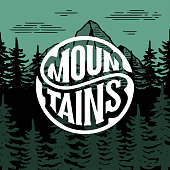 Mountains circle lettering circle on the forest