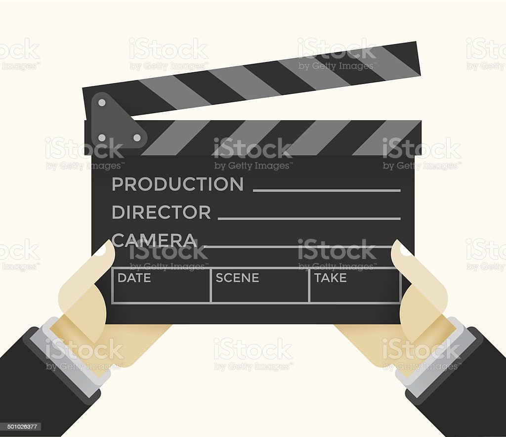Movie clapper with film information text in director's hands
