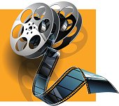 Movie film and film canisters on the orange background.