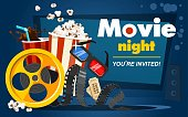 istock Movie night concept with popcorn, cinema tickets, drink, tape in cartoon style. Movie or cinema banner design. Vector movie promotional illustration 1237804526