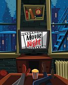 Movie night on TV in a warm apartment