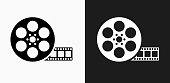 Movie Reel Icon on Black and White Vector Backgrounds. This vector illustration includes two variations of the icon one in black on a light background on the left and another version in white on a dark background positioned on the right. The vector icon is simple yet elegant and can be used in a variety of ways including website or mobile application icon. This royalty free image is 100% vector based and all design elements can be scaled to any size.