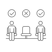 istock Movie theater reopen concept. Two men in seats with one empty chair. Social distancing in public places. 1256478122