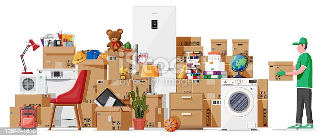 istock Moving to new house. Family relocated to new home. 1284741610