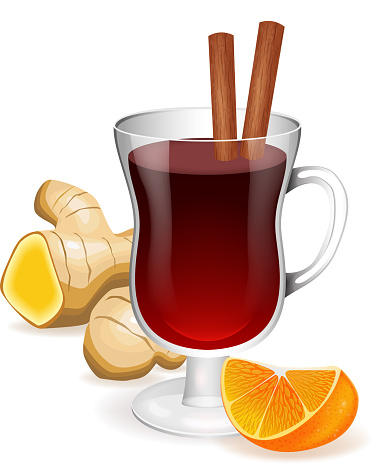 Mulled wine in the wineglass with cinnamon sticks, ginger and orange