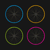 Multicolored Bicycle Rims on a Black Background. Bike Rims of Different Colors and Spokes. Blue, Yellow, Green and Purple Rims. Realistic Vector Illustration.