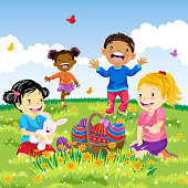 Multi-Ethnic kids enjoying Easter holiday with Easter eggs outdoors