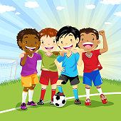 Multi-ethnic group of soccer boys in soccer field.