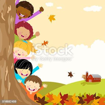 istock Multi-Ethnic Kids Hiding Behind Tree at Autumn 516682459