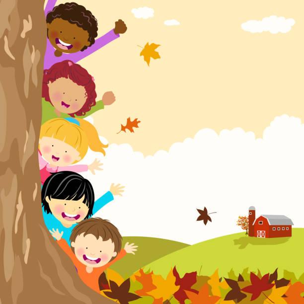 bildbanksillustrationer, clip art samt tecknat material och ikoner med multi-ethnic kids hiding behind tree at autumn - children autumn