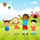 Multi-ethnic kids in front of the circus playing field.