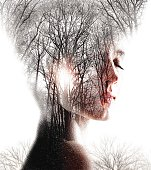 Multiple Exposure  of Woman Enjoying Forest