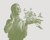 Multiple exposure of woman, hummingbirds and flowers
