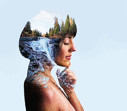 Multiple Exposure of young woman and river and waterfall