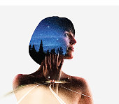 Multiple Exposure of young woman morphing into nature