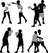 Multiple images of two boys boxing