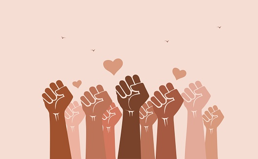 Multiracial crowd of human hands and fists raised in the air with love symbols - solidarity, celebration, diversity and inclusion concept