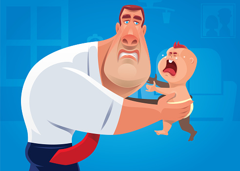 muscular businessman holding crying baby