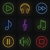 Music neon icons set: play buttons, notes, headphones and speaker