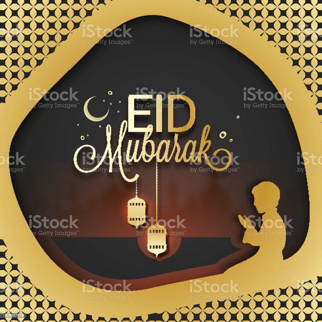 Muslim Boy Praying In Front Of Bokeh Mosque And Stylish Text Eid Mubarak Decorated With Hanging