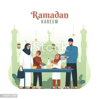 istock Muslim family preparing iftar meal 1305612060