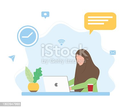 istock Muslim woman working at the table with laptop 1302647993