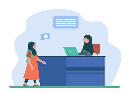 Muslim woman working on laptop and talking with girl