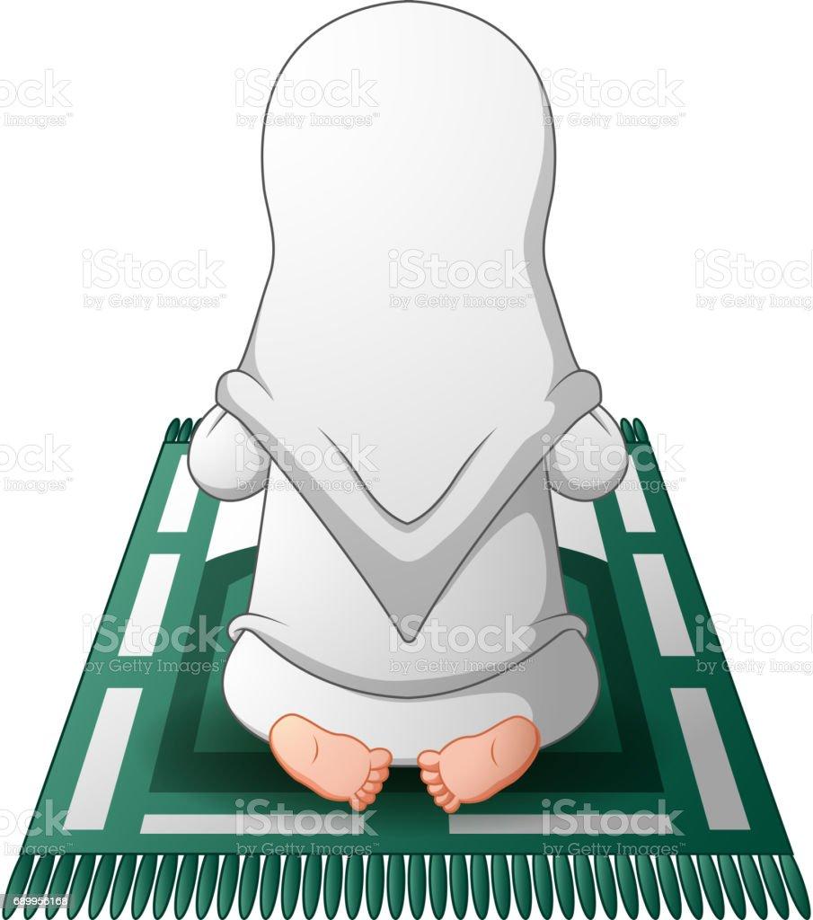 Muslim Women Sitting On The Prayer Rug While Praying Stock