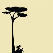 Girl silhouette sitting by a tall tree and reading a book. Copy space to write whatever you want.
