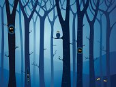 Mysterious forest with animals hiding between the trees at night