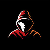 istock Mysterious man in a hood on a dark background 1249847791