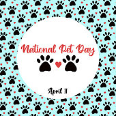 istock National Pet Day at April 11 greeting card, banner, post, template with round frame. Vector pattern with pet cat and dog paw, hearts. 1302842373