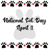 istock National Pet Day at April 11 greeting card with text, banner, post, template with pet paw icon border. Vector illustration with pet cat and dog foot print, hearts. Template for design 1311815246