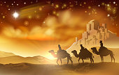 The three wise men magi on their journey following the star of Bethlehem and the city in the background. A nativity Christmas illustration