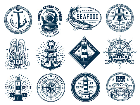 Nautical anchor, ship helm, lighthouse and fish
