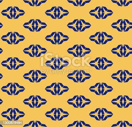 istock Navy blue and yellow geometric seamless pattern with triangular shapes, diamonds 1300829494