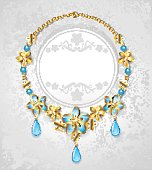 necklace of blue and gold flowers on a light background.
