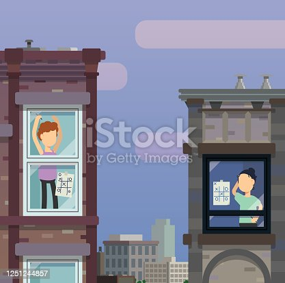istock Neighbors playing games from across the street, building to building and playing while social distancing 1251244857