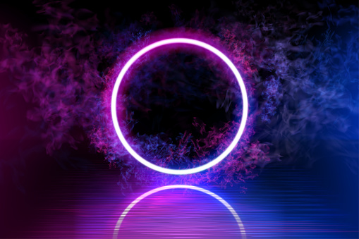 Neon color geometric circle on a dark background. Round mystical portal, luminous line, neon sign. Reflection of blue and pink neon light on the floor. Rays of light in the dark, smoke. Vector.