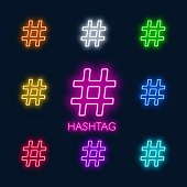Neon colorful symbols hashtag on a black background. Set of multi-colored signs.
