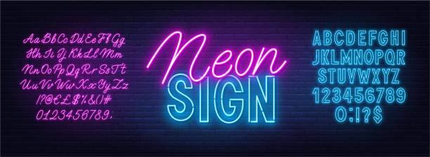 ilustraciones, imágenes clip art, dibujos animados e iconos de stock de fuente neon duo rosa y azul. alfabeto audaz y de escritura sobre un fondo de pared de ladrillo. - font