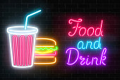 Neon food and drink glowing signboard on a dark brick wall background. Plastic cup of beverage and burger signs and text. Vector illustration.