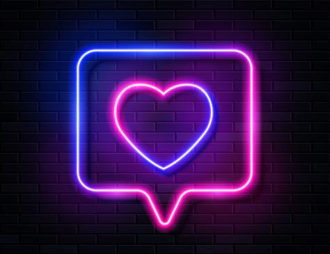 Neon Gradient Glowing Heart in Spech Bubble Banner on Dark Empty Grunge Brick Background.
