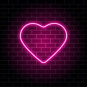 Neon heart. Bright night neon signboard on brick wall background with backlight. Retro pink neon heart sign. Design element for Happy Valentines Day. Night light advertising. Vector illustration.