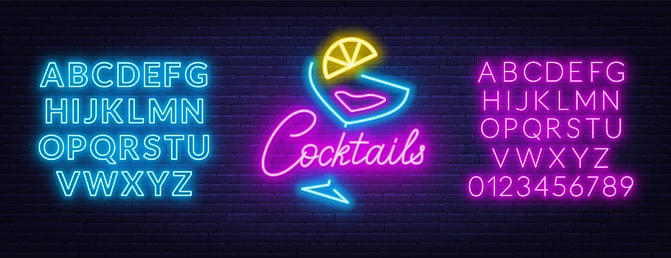 Neon lettering cocktails on brick wall background.