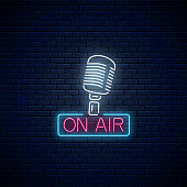 Neon on the air sign with retro microphone on dark brick wall background. Glowing signboard of radio station. Sound cafe icon. Music show poster. Vector illustration.